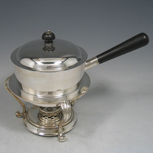 Edwardian silver plated egg coddler with wooden handle, burner stand, and internal egg holder, made in ca. 1900. Height 17 cms, width 13 cms.