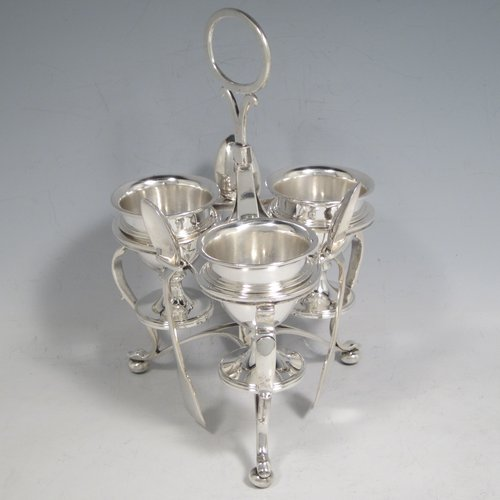 Antique Victorian sterling silver egg cruet set, having three removable plain round egg cups, and loop handle, all in a frame stand sitting on three scroll cushioned feet. The silver stand and egg cups are all made by Samuel Whitford of London in 1839, whilst the four spoons are in silver-plate. The dimensions of this fine hand-made silver egg cruet set are height 20 cms (8 inches), width 13.5 cms (5.3 inches), with a total weight of approx. 381g (12.3 troy ounces).