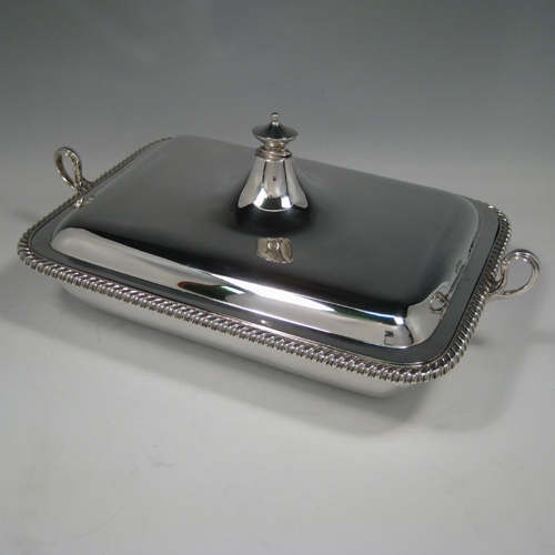 Antique Victorian sterling silver two-handled entree dish with cover and internal liner with space underneath to pour hot water. Made by Turner Bradbury of Sheffield in 1900. Length (inc. handles) 35 cms (13.75 inches), width 21.5 cms (8.5 inches), height (inc. finial) 14 cms (5.5 inches). Weight approx. 56 troy ounces (1,736g).