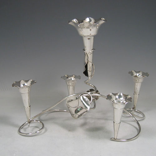 Sterling silver flower vase epergne with five removable vases made by Mappin & Webb of Sheffield in 1911. Length 32 cms, height 25 cms. Weight 22 troy ounces.