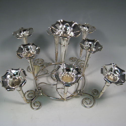 Antique Victorian silver plated flower-vase epergne with nine removable vases, all made in ca. 1890. Height 24 cms, spread 42 cms.