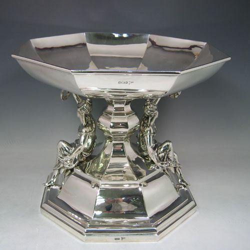 Sterling silver epergne bowl with figural supports made by Walker & Hall of Sheffield in 1911. With removable panelled bowl. Height 30 cms, width 36 cms.