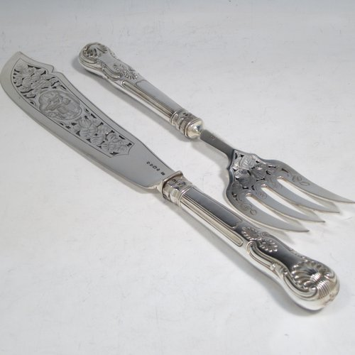 Antique early Victorian sterling silver fish serving knife and fork set, having filled handles in the double-struck Kings pattern, hand-pierced and hand-engraved blade and tines with floral and leaf decoration, the blade with a cartouche engraved with a lady holding a tray of fish. Made by Francis Higgins of London in 1849. The dimensions of this fine hand-made silver fish serving set are length of knife 33 cms (13 inches), and length of fork 24 cms (9.5 inches). Please note that the handles have a number of small dents, but are otherwise in very good condition.