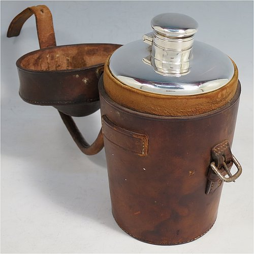An Antique Edwardian Silver Plated picnic whisky flask and beaker set, having a plain round body with tapering sides, and a bayonet-fit lid, together with two plain beakers with gold-gilt interiors, all fitted into their original leather carrying case. Made by James Dixon & Sons of Sheffield in ca. 1910. The dimensions of this fine hand-made silver-plated whisky flask and beaker combination set are height 15 cms (6 inches), and diameter at its widest point is 8.5 cms (3.3 inches).