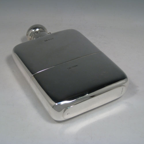 Sterling silver very large whisky hip flask, having a plain rectangular body with rounded shoulders, a screw-top fit lid with security chain, and a pull-off cup. Made by James Dixon of Sheffield in 1921. The dimensions of this fine hand-made silver whisky flask are length 23 cms (9 inches), width 14 cms (5.5 inches), depth 4 cms (1.5 inches) and it weighs approx. 878g (28 troy ounces).