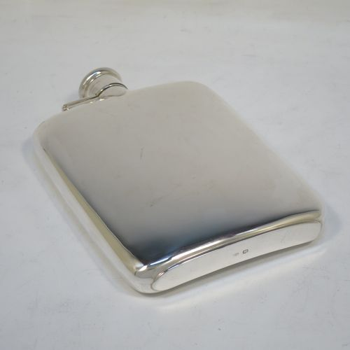 A handsome Sterling Silver whisky hip flask, having a plain shaped rectangular body with rounded shoulders, and a bayonet-fit lid with knurled edge. Made by Henry Atkins of Sheffield in 1946. The dimensions of this fine hand-made silver hip whisky flask are length 15 cms (6 inches), width 10 cms (4 inches), depth 2 cms (0.75 inch), and it weighs approx. 215g (7 troy ounces).