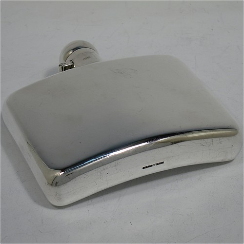 A Sterling Silver whisky hip flask, having a plain rectangular body with rounded corners and curved sides, and with a bayonet-fit lid. Made by Stokes & Ireland Ltd., of Chester in 1921. The dimensions of this fine hand-made silver whisky flask are height 11 cms (4.25 inches), width 10 cms (4 inches), depth 2 cms (0.75 inches), and it weighs approx. 175g (5.6 troy ounces).