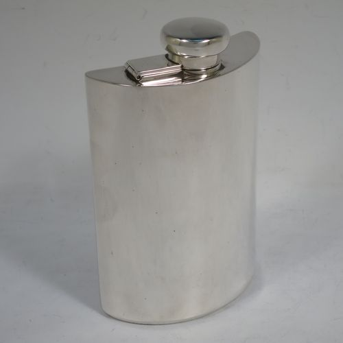 A handsome Antique Sterling Silver whisky hip flask, having a plain shaped rectangular body, curved to fit in a waist-coat pocket against the belly, and a bayonet-fit round flat-topped lid. Made by Percy Whitehouse of London in 1915. The dimensions of this fine hand-made antique silver hip whisky flask are length 14 cms (5.5 inches), width 8.5 cms (4.3 inches), depth 3 cms (1.25 inch), and it weighs approx. 192g (6.2 troy ounces).