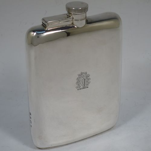 A large and handsome Sterling Silver whisky hip flask, having a plain shaped rectangular body with rounded shoulders, and a bayonet-fit lid with knurled edge. Made by William Neale Ltd., of Birmingham in 1924. The dimensions of this fine hand-made silver hip whisky flask are length 15 cms (6 inches), width 11 cms (4.25 inches), depth 2 cms (0.75 inch), and it weighs approx. 226g (7.3 troy ounces). Please note that this item is crested on one side.