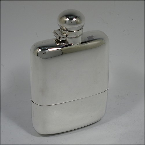 A very handsome Antique Victorian Sterling Silver whisky hip flask, having a plain shaped rectangular body with rounded shoulders, a bayonet-fit lid, and a pull-off cup with gold-gilt interior. Made by James Dixon and Sons of Sheffield in 1896. The dimensions of this fine hand-made antique silver whisky flask are length 12.5 cms (5 inches), width 8 cms (3.25 inches), depth 2.5 cms (1 inch), and it weighs approx. 209g (6.7 troy ounces).