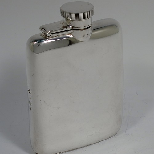A Sterling Silver whisky hip flask, having a plain shaped rectangular body with rounded shoulders, and a hinged bayonet-fit lid with knurled thumb-piece. Made by William Neale of Birmingham in 1942. The dimensions of this fine hand-made silver whisky flask are length 10 cms (4 inches), width 7 cms (2.75 inches), depth 2 cms (0.75 inches) and it weighs approx. 108g (3.5 troy ounces).