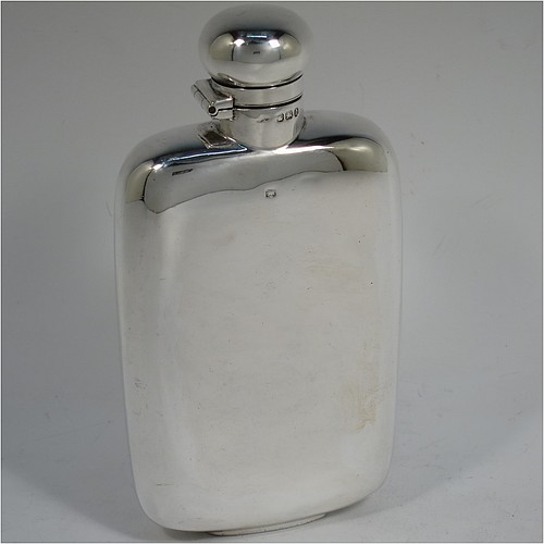 A very handsome Antique Victorian Sterling Silver whisky hip flask, having a plain shaped rectangular body with rounded shoulders, and a bayonet-fit lid. Made by Walker and Hall of Sheffield in 1896. The dimensions of this fine hand-made antique silver hip whisky flask are length 15 cms (6 inches), width 8 cms (3 inches), depth 3 cms (1.25 inch), and it weighs approx. 189g (6 troy ounces).