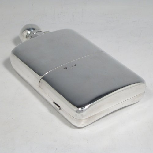 Antique Victorian sterling silver combination whisky hip flask with cigarette case, having a plain shaped rectangular body with rounded shoulders, a bayonet-fit lid, and a hinged side cover with clasp. Made by John Newton Mappin of London in 1893. The dimensions of this fine hand-made silver whisky flask are length 16.5 cms (6.5 inches), width 9 cms (3.5 inches), depth 2.5 cms (1 inch), and it weighs approx. 265g (8.5 troy ounces).