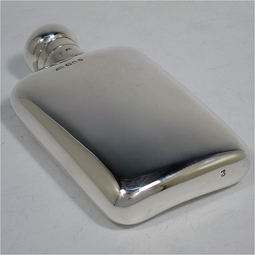 A handsome Sterling Silver whisky hip flask, having a plain shaped rectangular body with rounded shoulders, and a bayonet-fit lid. Made by Henry Wigfall of London in 1922. The dimensions of this fine hand-made silver hip whisky flask are length 13 cms (5 inches), width 7 cms (2.75 inches), depth 2.5 cms (1 inch), and it weighs approx. 108g (3.5 troy ounces).
