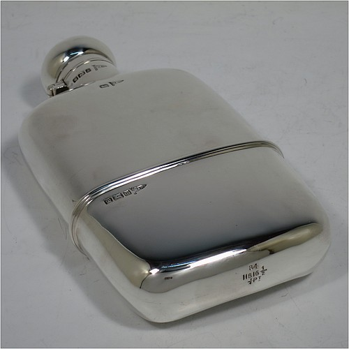A very handsome Antique Sterling Silver whisky hip flask, having a plain shaped rectangular body with rounded shoulders, a bayonet-fit lid, and a pull-off cup with gold-gilt interior. Made by Walker and Hall of Sheffield in 1911. The dimensions of this fine hand-made antique silver whisky flask are length 14 cms (5.5 inches), width 7.5 cms (3 inches), depth 2.5 cms (1 inch), and it weighs approx. 172g (5.5 troy ounces).