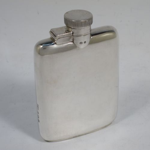 A handsome Sterling Silver whisky hip flask, having a plain shaped rectangular body with rounded shoulders, and a hinged bayonet-fit lid with knurled thumb-piece. Made by Mappin and Webb of Birmingham in 1928. The dimensions of this fine hand-made silver whisky flask are length 10 cms (4 inches), width 7 cms (2.75 inches), depth 2 cms (0.75 inches) and it weighs approx. 104g (3.4 troy ounces).