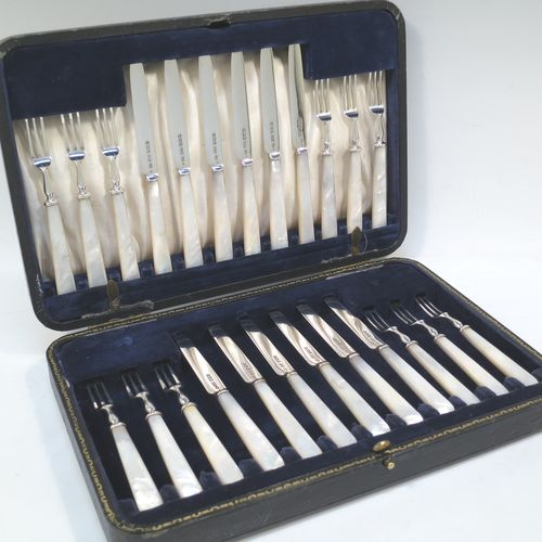 A very elegant Antique Sterling Silver and mother-of-pearl handled fruit set for twelve people. Having plain straight-sided pointed-end blade knives, and three-prong forks. All fitted into an original presentation box with cream satin and dark blue velvet interior. Made by James Dixon and Sons of Sheffield in 1925. The dimensions of this fine hand-made antique silver fruit service are length of knife 19 cms (7.5 inches), and the length of the fork 13.5 cms (5.25 inches).