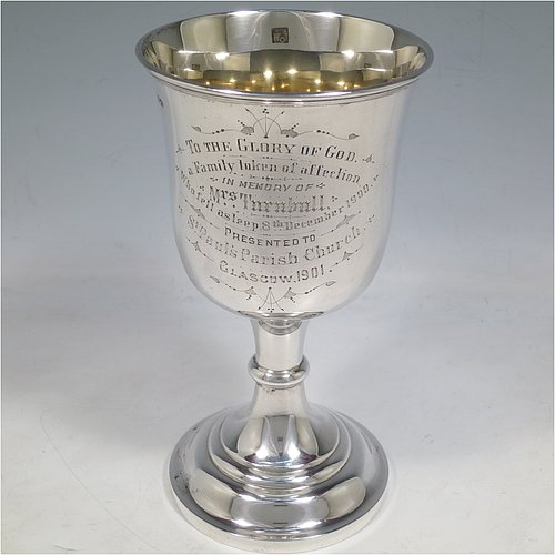 A large Antique Victorian Sterling Silver goblet, having a plain round baluster body with applied reeded border, hand-engraved on one side with a contemporaneous full inscription, a gold-gilt interior, and sitting on a pedestal foot. Made by Walker & Hall of Sheffield in 1901. The dimensions of this fine hand-made antique silver goblet are height 19.5 cms (7.75 inches), diameter at lip 11 cms (4.25 inches), and it weighs approx. 375g (12 troy ounces).