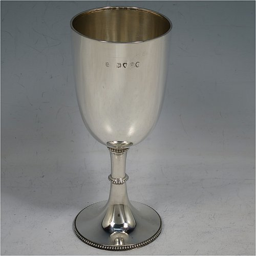 An Antique Victorian Sterling Silver small goblet, having a plain round tapering body, and sitting on a pedestal foot with applied bead-edged borders. Made by Mappin & Webb of London in 1876. The dimensions of this fine hand-made antique silver goblet are height 14 cms (5.5 inches), diameter at lip 6 cms (2.3 inches), and it weighs approx. 89g (2.9 troy ounces).