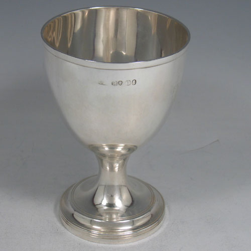 Antique Georgian sterling silver goblet, having a round tapering body with reeded borders, and sitting on a pedestal foot. Made by William Bateman (poss.) of London in 1826. The dimensions of this fine hand-made silver goblet are height 12.5 cms (5 inches), diameter at lip 9 cms (3.5 inches), and it weighs approx. 168g (5.4 troy ounces).