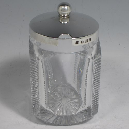 An Antique Victorian sterling silver and hand-cut crystal jam, honey, or preserve jar, having a plain pull-off lid with ball finial, and a hand-cut crystal body with star-cut base. Made by Heath & Middleton of Birmingham in 1900. The dimensions of this fine hand-made silver and crystal jar are height 11.5 cms (4.5 inches), and 7 cms (2.75 inches) square.