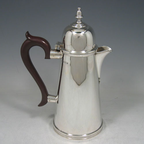 Sterling silver Georgian style straight-sided hot water pot made by J.B. Chatterley & Sons of Birmingham in 1966. Height 24 cms.