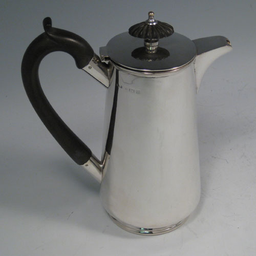 Sterling silver very plain straight-sided hot water / milk jug with wooden handle and finial. Made by J.B. Chatterley & Sons of Birmingham in 1912. Height 18 cms (7 inches), length (across handle and spout) 16 cms (6.5 inches). Weight approx. 11 troy ounces (341g).