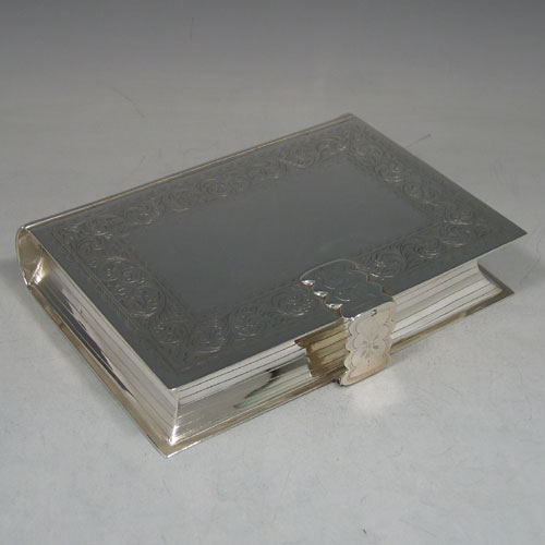 Antique Victorian silver plated 'book form' double inkstand with stamp box and pen rest. Made by Mappin Bros of London circa 1870. Length 18 cms, width 14 cms.