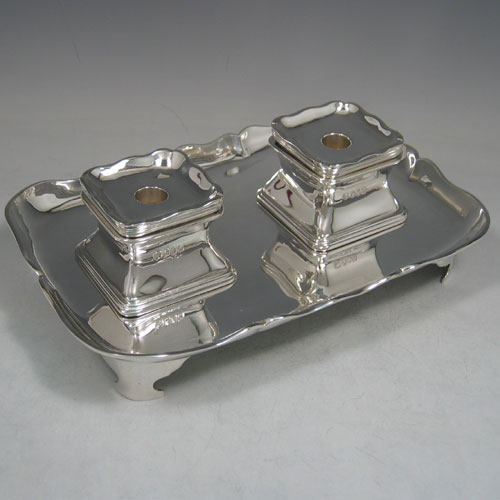 Antique Edwardian Britannia silver standard double inkstand made by Henry Lambert of London in 1905. Length 25 cms, width 17 cms.