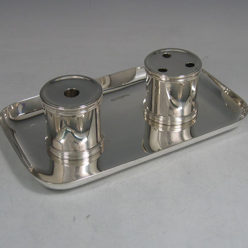 Sterling silver heavy double inkstand made by Robert Comyns of London in 1934. Length 22 cms, width 13 cms.