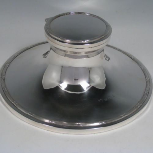 Sterling silver large Capstan inkwell with Ribbon and Reed borders, and glass liner. Made in Birmingham in 1911. Height 8.5 cms (3.75 inches), diameter 20 cms (8 inches).