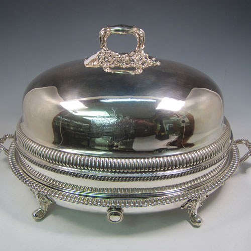 Antique Georgian Old Sheffield plated meat cover dome and platter, having a plain oval body with Regency style gadroon and fluted border, a cast oak-leaf handle, and all sitting on a well and tree dish for carving, having a hot water jacket, and with matching decoration. Both pieces made in ca. 1815 and matched together. The dimensions of this fine hand-made Old Sheffield plated meat cover dome and plate are length (inc. handles) 71cm (28 inches), width 44.5 cms (17.5 inches), and height 36 cms (14 inches). Please note that both items are crested.