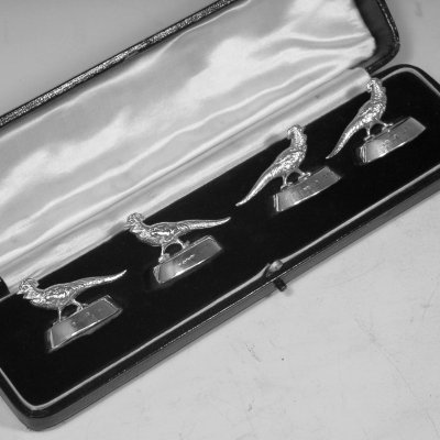 Sterling silver set of four Pheasant place card holders in original box, made in Chester, 1922. Length 4.5 cms.