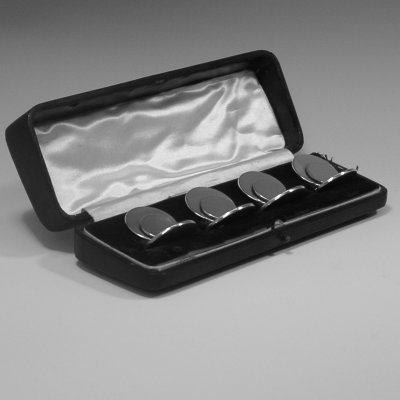Sterling silver set of four place card holders made by Samuel Morden of Chester in 1913. Height 3 cms.