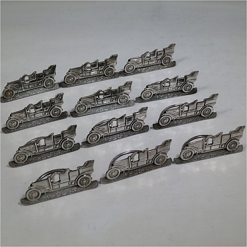 A very rare Antique Edwardian Sterling Silver set of twelve place card or menu card holders, having bodies in the shape of vintage motor cars, each mounted on a base with a semi-circular wire foot and slots for menus or place-cards. Made in Birmingham in 1907. The dimensions of this fine set of antique silver menu or place card holders are length 6.5 cms (2.5 inches), height 3 cms (1.2 inches), depth 3cms (1.2 inches), and they weigh a total of approx. 221g (7 troy ounces).