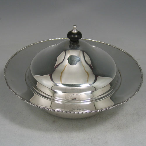 Sterling silver muffin dish with original liner and cover. Made by Henry Blankensee of Chester in 1912. Diameter 19 cms. Weight approx. 15 troy ounces.