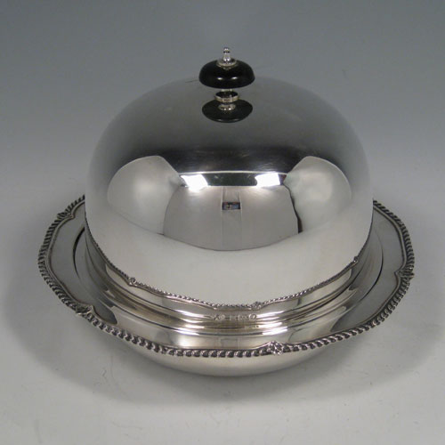 Sterling silver covered butter / muffin dish with liner, and shaped gadroon edges, made in London in 1931. Diameter 19 cms (7.5