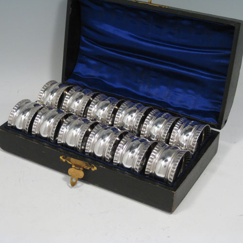 Sterling silver napkin rings in a set of twelve, in their original satin and velvet-lined presentation box. Made by James Dixon & Sons of Sheffield in 1920. Dimensions of each silver napkin ring: diameter 4 cms (1.5 inches), height 2.5 cms (1 inch). Weight approx. 12 troy ounces (372g).