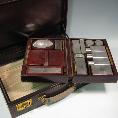 Sterling silver necessaire in original leather travel case. Having a hair brush, clothes brush, easel mirror, six boxes of various shapes and sizes, a toothbrush holder, a glass lined inkwell box, three cologne bottles, and a leather bound manicure set (some items missing from this). All made by Goldsmiths and Silversmiths of London in 1929.