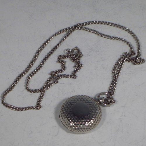 An Antique Edwardian Sterling silver single Sovereign case and original chain, having a round body with hand-hammered decoration and in the shape of a Hunter fob watch, with hinged lid, internal sprung mechanism which is in working order, and push-button clasp, all made by Alexander Davenport of Birmingham in 1908. The dimensions of this fine hand-made silver sovereign case are length 4 cms (1.5 inches), and it weighs a total of 39g (1.25 troy ounces).