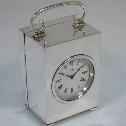 A very handsome Antique Victorian Sterling Silver carriage clock, having a very plain rectangular upright body, with a hinged back door opening to the original clock movement mechanism and winder, a hinged and scrolled top carrying handle, and all sitting on four cushion feet. Made by George Bower of Birmingham in 1900. The dimensions of this fine hand-made antique silver carriage clock are height 9 cms (3.5 inches), width 6.5 cms (2.5 inches), and depth 5 cms (5 inches). Please note that this clock has been serviced and works properly.