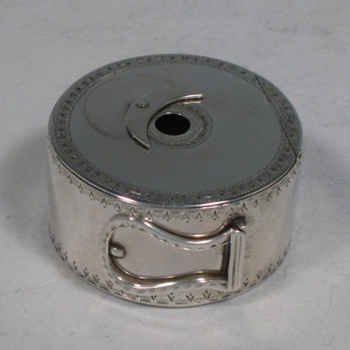 Antique Georgian sterling silver bougie-box, having a cylindrical body with bright-cut engraved bands of decoration, a flat invisibly hinged lid, an attached sickle moon-shaped wax trimmer, and a hinged buckle style loop handle. Made by Thomas Phipps and Edward Robinson II of London in 1785. Please note that the hallmark also includes a rare incuse duty mark (George III looking left), which was only in use for 18 months (between 1st December 1784 and 29th May, 1786). The dimensions of this fine hand-made silver bougie-box are diameter 5 cms (2 inches), height 2.5 cms (1 inch), and it weighs approx. 53g (1.7 troy ounces).