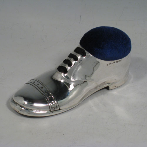 Antique Edwardian sterling silver pin cushion, in the shape of a shoe, having a plain body with laces and an applied decorative band. The dimensions of this fine hand-made silver pin cushion are length 12 cms (4.75 inches), and width 5 cms (2 inches).
