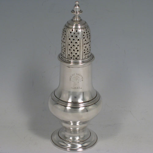 Antique Georgian sterling silver pepper pot, having a plain baluster body, and sitting on a pedestal foot. Made by Albartus Schuman of London in 1762. Height 14 cms (5.5 inches), diameter of main body 5 cms (2 inches). Weight approx. 115g (3.7 troy ounces). Please note that this item is crested.