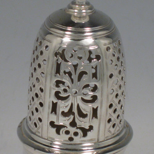 Antique Georgian sterling silver pepper pot, having a plain baluster body, a hand-pierced pull-off lid with urn-shaped finial, and sitting on a pedestal foot. Made by Samuel Woods of London in 1747. The dimensions of this fine hand-made silver pepper pot are height 15 cms (6 inches), diameter of main body 6 cms (2.3 inches), and it weighs approx. 148g (4.8 troy ounces). Please note that this item is crested.