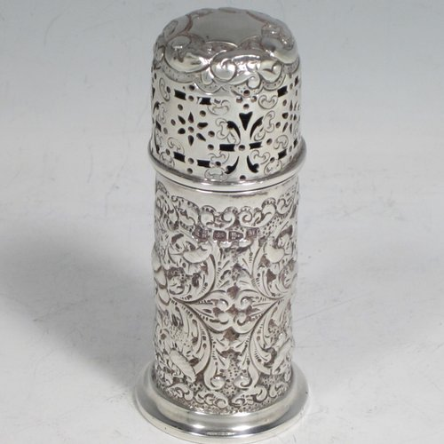 Antique Victorian sterling silver pepper pot (or small sugar caster), having a cylindrical body with hand-chased floral decoration, a hand-pierced pull-off lid, and sitting on a collet foot. Made by Nathan & Hayes of Chester in 1895. The dimensions of this fine hand-made silver caster / pepper pot are height 10 cms (4 inches), diameter at base main body 4 cms (1.5 inches), and it weighs approx. 85g (2.7 troy ounces)