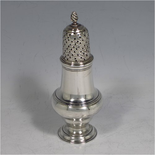An Antique Georgian sterling silver pepper pot, having a plain round baluster body, a hand-pierced pull-off lid with flame finial, and sitting on a pedestal foot. Made by James Delmester of London in 1766. The dimensions of this fine hand-made antique silver pepper pot are height 12 cms (4.75 inches), diameter of main body 4.5 cms (1.75 inches), and it weighs approx. 63g (2 troy ounces).