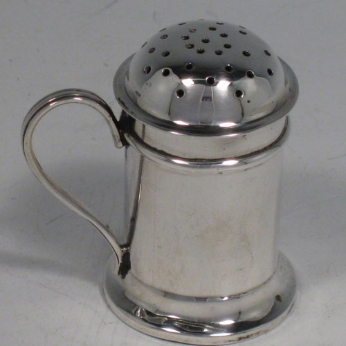 Antique Victorian sterling silver Kitchen pepperette, having a round straight-sided body, pull-off hand-pierced lid, and a scroll handle. Made by Nathan and Hayes of Birmingham in 1892. Height 5 cms (2 inches), length 5 cms (2 inches). Weight approx. 31g (1 troy ounce).