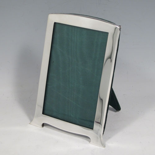 Sterling silver portrait photograph frame, having a hand-made rectangular body with slightly domed top and two Art Nouveau style feet, with a dark green velvet-backed easel frame. Made in Birmingham in 1919. The dimensions of this fine hand-made silver photo frame are height 12 cms (4.75 inches), and width 7.5 cms (3 inches).