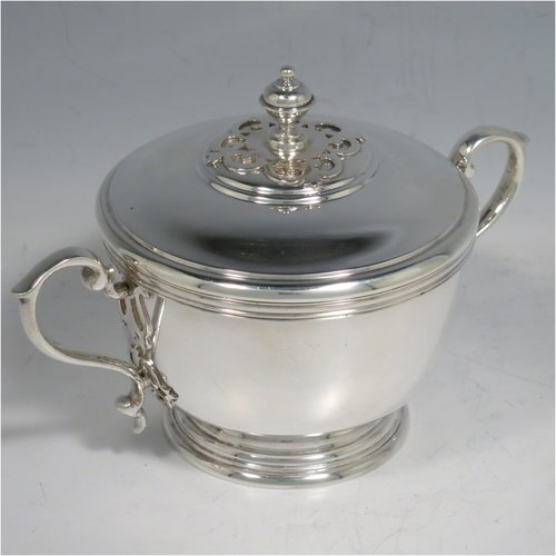 A Sterling Silver porringer, having a round baluster body, with two scroll side handles, a pull-off cover with cast finial, with applied cut-card work decoration around the handles & finial, and all sitting on a collet foot. Made by Haviland of London in 1971. The dimensions of this fine hand-made silver porringer are height 11 cms (4.3 inches), spread across arms 16 cms (6.25 inches), and it weighs approx. 361g (11.6 troy ounces).